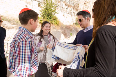 A Boy having a Bar Mitzvah in Israel in front of the Wailing Wall